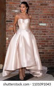 NEW YORK, NY - April 14, 2018: A model poses at the Maggie Sottero Bridal Spring 2019 Collection Presentation Show during NY Fashion Week Bridal
