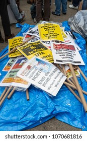 New York, NY - April 15, 2018: Posters laying on floor during anti-US rally by Take Action NYC Leftists organizations on Herald Square
