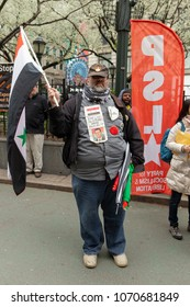 New York, NY - April 15, 2018: Supporter of Syrian President Assad attends anti-US rally by Take Action NYC Leftists organizations on Herald Square