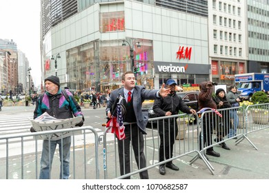 New York, NY - April 15, 2018: Supporters of President Trump agenda argue across police line during anti-US rally by Take Action NYC Leftists organizations on Herald Square