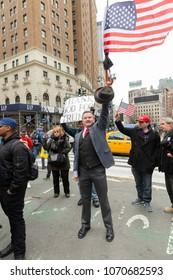 New York, NY - April 15, 2018: Supporters of President Trump agenda attend anti-US rally by Take Action NYC Leftists organizations on Herald Square