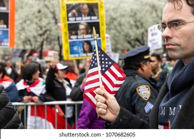 New York, NY - April 15, 2018: President Trump suporter attends protest during anti-US rally by Take Action NYC Leftists organizations on Herald Square