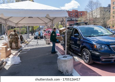 New York, NY - April 15, 2020: TLC black taxi cars lined up to deliver food for elderly and disabled New Yorkers amid COVID-19 pandemic