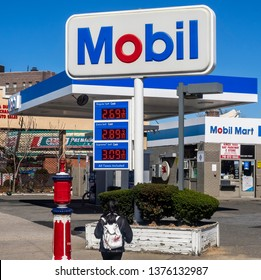 New York, NY - April 16, 2019: Exterior of Mobil gas station in Brooklyn, NY. Mobil is a major American oil company that merged with Exxon in 1999 to form a parent company called ExxonMobil.