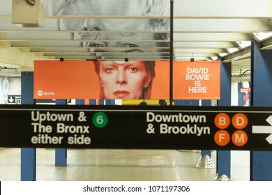 New York, NY - April 17, 2018: Music streaming company Spotify installed tribute to David Bowie on New York subway station Broadway-Lafayette street