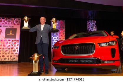 New York, NY - April 17, 2019: Ian Callum  celebrates award for world car of the year, best design, green car of the year for I-Pace Jaguar at 2019 New York International Auto Show at Jacob Javits Cen