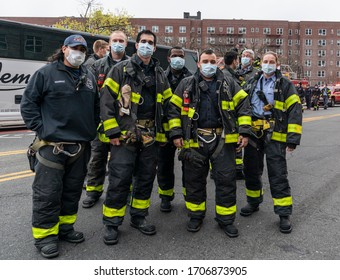 New York, NY - April 17, 2020: First responders attend mayor Bill de Blasio address medical staff at 7pm to thank for their work during COVID-19 pandemic at Elmhurst Hospital