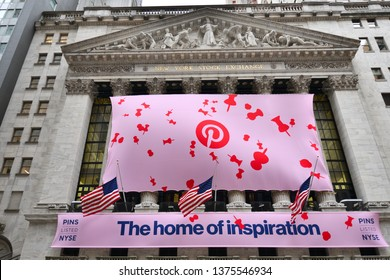NEW YORK, NY - APRIL 18, 2019: The New York Stock Exchange is seen with a pink banner during the Pinterest IPO on Wall Street.