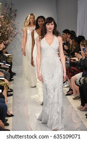 NEW YORK, NY - APRIL 20: Models walk the runway finale at the Theia show during New York Fashion Week: Bridal at the Theia Showroom on April 20, 2017 in New York City.