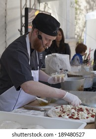 NEW YORK, NY - APRIL 26, 2014: Chef Ben Dawson of American Flatbread demonstrates cooking technique for pizza at Family festival during the 2014 Tribeca Film festival on Greenwich street