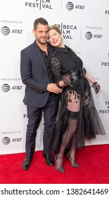New York, NY - April 27, 2019: Nabil Elderkin and Amber Heard wearing dress by Claes Iversen, shoes by Christian Louboutin attend world premiere of Gully during Tribeca Film Festival at SVA Theatre