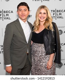 """New York, NY - April 27, 2019: Director Takashi Dossier and his wife attend the World premiere of """"Only"""" during the 2019 Tribeca Film Festival at SVA Theater"""