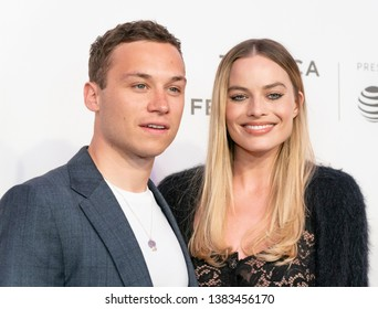 New York, NY - April 28, 2019: Finn Cole and Margot Robbie wearing dress by Chanel attend World premiere of movie Dreamland at Stella Artois Theatre at BMCC TRAC