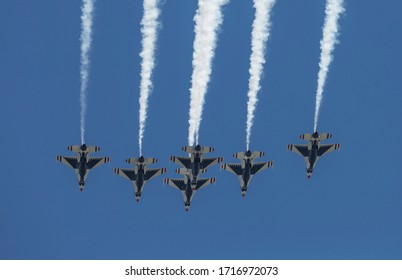 New York, NY - April 28, 2020: U.S. Air Force Thunderbirds flying in formation over city to pay tribute to honor COVID-19 frontline workers