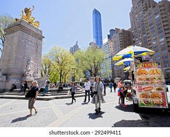 New York, NY - April 29, 2015: Columbus Circle in Manhattan on a bright sunny day