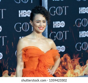 New York, NY - April 3, 2019: Nathalie Emmanuel wearing dress by Ermanno Scervino attends HBO Game of Thrones final season premiere at Radio City Music Hall