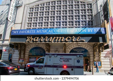 New York, NY - April 3, 2019: View of the marquee and sign for the famous Barrymore Theater in the Theater District of Manhattan New York City. There is an ambulance in front of theater