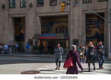 New York, NY - April 3, 2019: Marquee at Rockefeller Center with a sign for The Tonight Show starring Jimmy Fallon with people walking by on the sidewalk and street