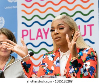 New York, NY - April 30, 2019: Ashanti wearing suit by Escada attends press briefing on upcoming Play it Out Concert to beat plastic pollution at UN Headquarters