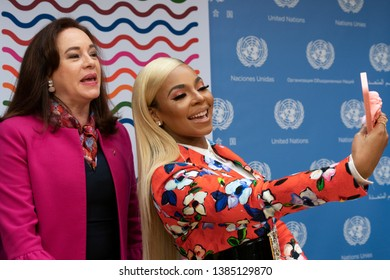 New York, NY - April 30, 2019: President of GAy Maria Fernanda Espinosa Garces & Ashanti do selfie after press briefing on upcoming Play it Out Concert to beat plastic pollution at UN Headquarters