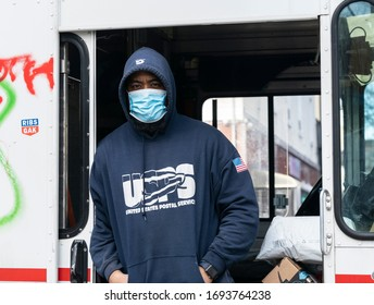 New York, NY - April 4, 2020: During COVID-19 outbreak some workers became essential for all necessary services like this postal worker from Brooklyn
