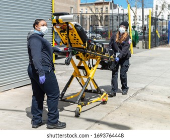 New York, NY - April 4, 2020: EMT members from Ohio arrived to help with COVID-19 emergency in New York City stand next to Wyckoff Heights Medical Center in Brooklyn