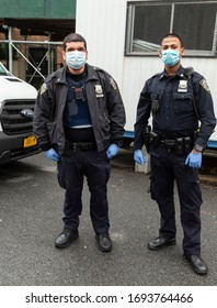 New York, NY - April 4, 2020: During COVID-19 outbreak some workers became essential for all necessary services like this police officers from NYPD 88th precinct in Brooklyn
