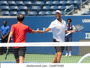 New York, NY - Aug 22 2018: John McEnroe, Patrick McEnroe, James Blake, Michael Chang play exhibition match during New Luis Armstrong stadium dedication at USTA Billie Jean King National Tennis Center