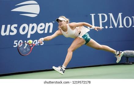New York, NY - Aug 30, 2018: Eugenie Bouchard of Canada returns ball during US Open 2018 2nd round match against Marketa Vondrousova of Czech Republic at USTA Billie Jean King National Tennis Center