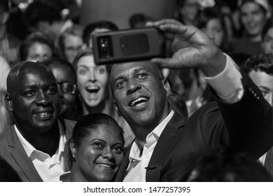 New York, NY - August 12, 2019: Democratic presidential candidate US Senator Cory Booker poses for photos with supporters at campaign grassroots Happy Hour fundraiser event at the nightclub Slate