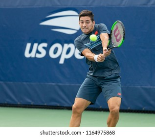New York, NY - August 21, 2018: Christian Garin of Chile returns ball during qualifying day 1 against Evan King of USA at US Open Tennis championship at USTA Billie Jean King National Tennis Center