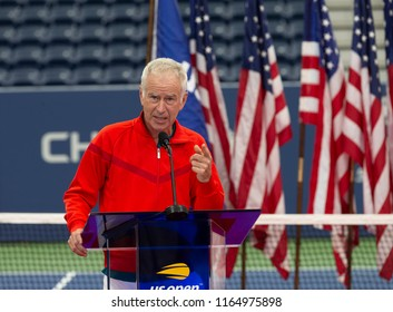 New York, NY - August 22, 2018: John McEnroe speaks during New Luis Armstrong stadium dedication at USTA Billie Jean King National Tennis Center