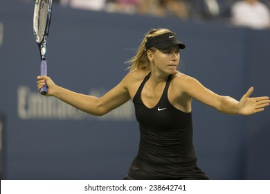 NEW YORK, NY - AUGUST 25: Maria Sharapova of Russia returns ball during 1st round match against Maria Kirilenko of Russia at US Open tennis tournament in Flushing Meadows USTA Tennis Center 2014