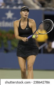 NEW YORK, NY - AUGUST 25: Maria Sharapova of Russia serves ball during 1st round match against Maria Kirilenko of Russia at US Open tennis tournament in Flushing Meadows USTA Tennis Center 2014