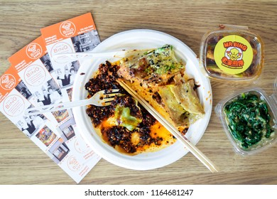NEW YORK, NY - AUGUST 26 2018: Plate of Chinese dumplings and bings from Mr. Bing restaurant and food cart in New York City