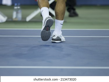 NEW YORK, NY - AUGUST 26: Roger Federer of Switzerland shows Nike Air Jordan sneakers during 1st round match against Marinko Matosevic of Australia at US Open in Flushing Meadows USTA Tennis Center