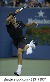 NEW YORK, NY - AUGUST 26: Roger Federer of Switzerland returns ball during 1st round match against Marinko Matosevic of Australia at US Open tennis tournament in Flushing Meadows USTA Tennis Center
