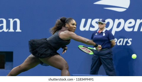 New York, NY - August 27, 2018: Serena Williams of USA returns ball during US Open 2018 1st round match against Magda Linette of Poland at USTA Billie Jean King National Tennis Center