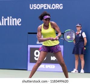 New York, NY - August 27, 2018: Venus Williams of USA returns ball during US Open 2018 1st round match against Svetlana Kuznetsova of Russia at USTA Billie Jean King National Tennis Center