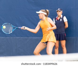 New York, NY - August 27, 2018: Sofia Kenin of USA returns ball during US Open 2018 1st round match against Madison Brengle of USA at USTA Billie Jean King National Tennis Center