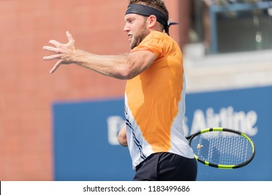 New York, NY - August 27, 2018: Jack Sock of USA returns ball during US Open 2018 1st round match against Guido Andreozzi of Argentina at USTA Billie Jean King National Tennis Center