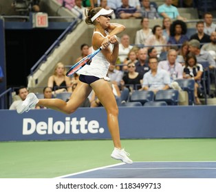 New York, NY - August 27, 2018: Magda Linette of Poland returns ball during US Open 2018 1st round match against Serena Williams of USA at USTA Billie Jean King National Tennis Center