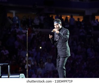 New York, NY - August 27, 2018: Singer Maxwell performs National Anthem during US Open 2018 opening ceremony on Arthur Ashe stadium at USTA Billie Jean King National Tennis Center