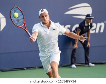 New York, NY - August 27, 2018: Denis Kudla of USA returns ball during US Open 2018 1st round match against Matteo Berrettini of Italy at USTA Billie Jean King National Tennis Center
