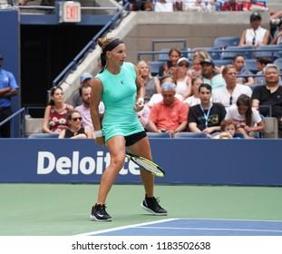 New York, NY - August 27 2018: Svetlana Kuznetsova of Russia returns ball between legs during US Open 2018 1st round match against Venus Williams of USA at USTA Billie Jean King National Tennis Center