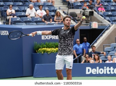 New York, NY - August 27, 2018: Stan Wawrinka of Switzerland serves during US Open 2018 1st round match against Grigor Dimitrov of Bulgaria at USTA Billie Jean King National Tennis Center