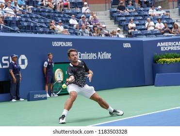 New York, NY - August 27, 2018: Stan Wawrinka of Switzerland returns ball during US Open 2018 1st round match against Grigor Dimitrov of Bulgaria at USTA Billie Jean King National Tennis Center