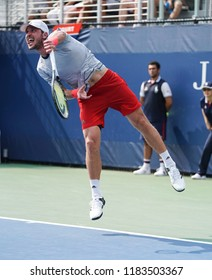 New York, NY - August 27, 2018: Mischa Zverev of Germany serves during US Open 2018 1st round match against Taylor Fritz of USA at USTA Billie Jean King National Tennis Center