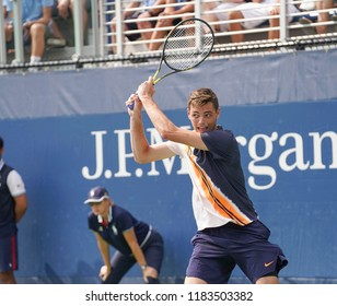 New York, NY - August 27, 2018: Taylor Fritz of USA returns ball during US Open 2018 1st round match against Mischa Zverev of Germany at USTA Billie Jean King National Tennis Center
