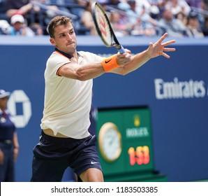 New York, NY - August 27, 2018: Grigor Dimitrov of Bulgaria returns ball during US Open 2018 1st round match against Stan Wawrinka of Switzerland at USTA Billie Jean King National Tennis Center